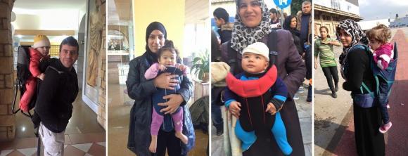 Att få bägge händerna fria underlättar enormt mycket för småbarnsföräldrarna. Här är några av de mycket tacksamma mottagarna av bärselarna som skänkts från Sverige.